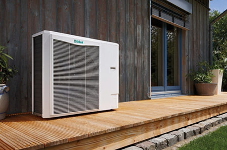 air source heat pump installed on outdoor decking