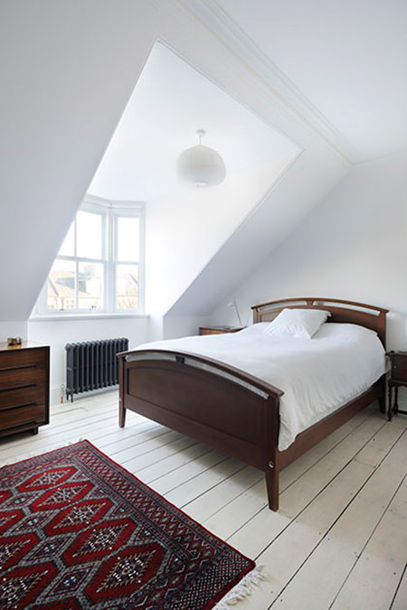 Brilliant white painted loft bedroom
