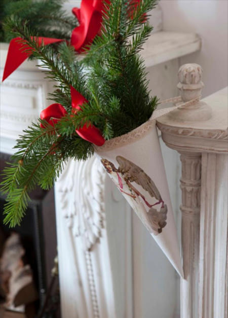 Decorative cone containing sprig of fir tree with red ribbons