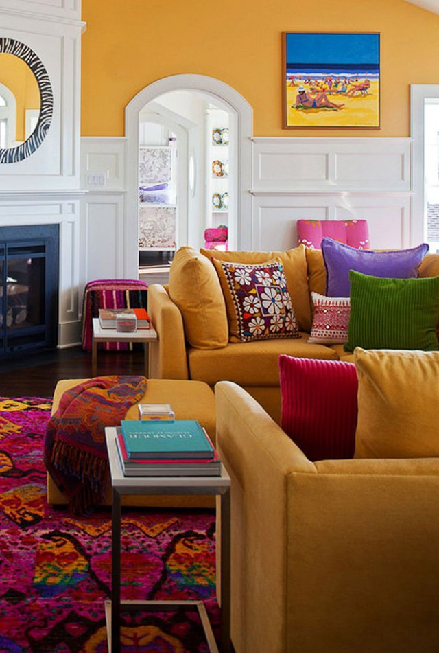 Sitting room with mustard coloured walls and sofas