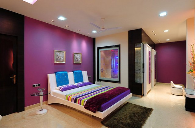Bedroom with purple painted walls