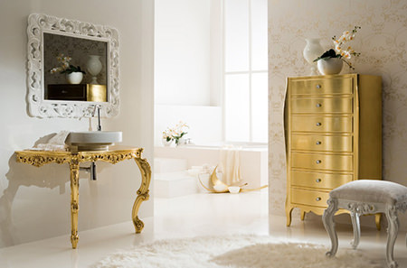 Powder room with tall gold chest of drawers and console table being used to house a hand basin