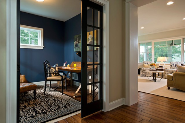 Traditional styled home office with indigo painted walls