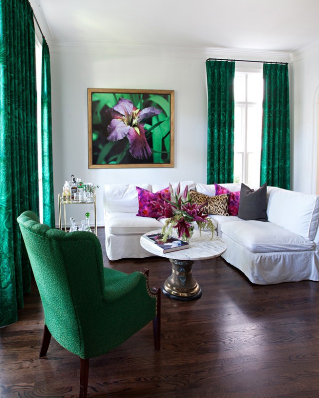 Sitting room with white painted walls and malachite patterned curtains
