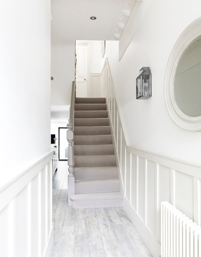 Hallway stairs carpeted in grey ombré tones