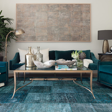 sitting room with petrol blue sofas and carpet