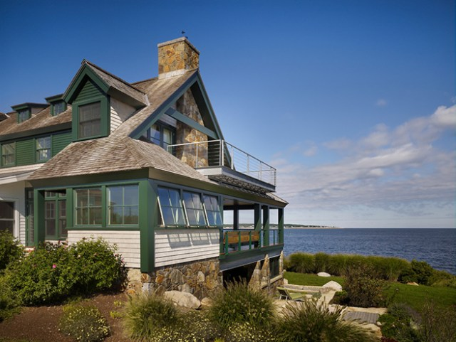 Coastal house painted racing green & white
