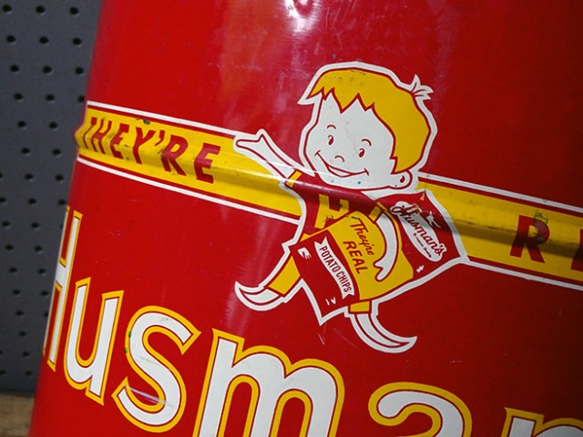 Cartoon image of a boy on a vintage Husman's Potato Chip tin | H is for Home