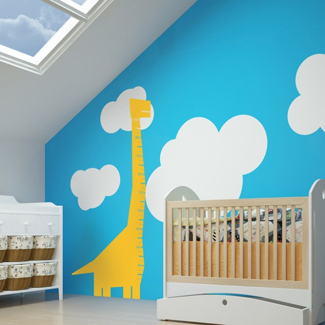 Yellow vinyl dinosaur height chart sticker on a bedroom wall