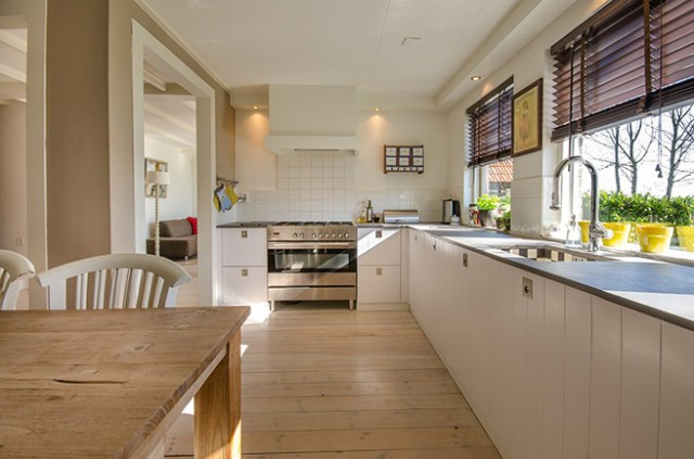 Kitchen diner with wooden floorboard floor