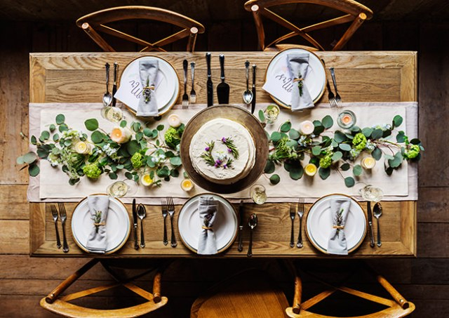 Table and chairs with place settings and centrepiece