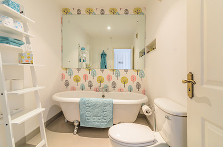Brightly-coloured, wallpapered bathroom wall
