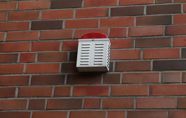 Wall-mounted burglar alarm