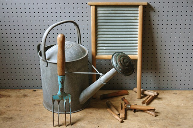 Collection of vintage laundry and garden implements including wooden clothes pegs, washboard, watering can and hand fork | H is for Home