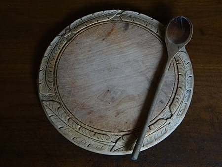 Antique carved wooden bread board and spoon