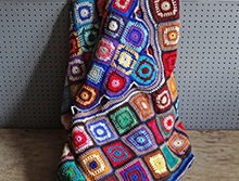 Vintage multi-coloured granny squares crocheted blanket