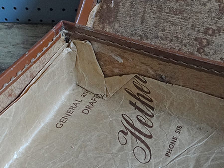 details of interior of vintage leather suitcase