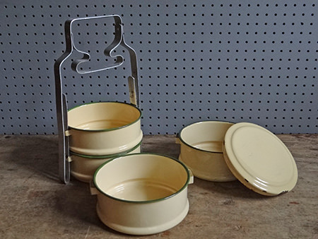 vintage cream enamel tiffin bowls unstacked