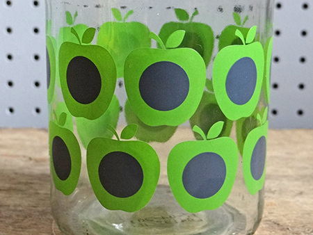 detail of a Douwe Egberts coffee jar with green Orla Kiely pattern