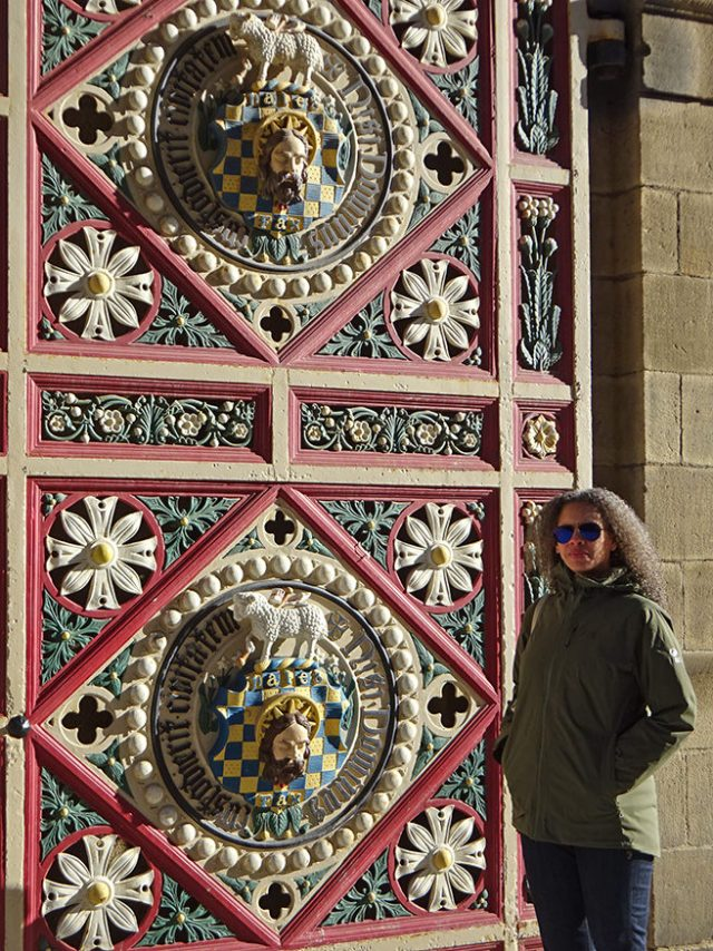 Adelle standing at one of the huge gates leading into Piece Hall | H is for Home