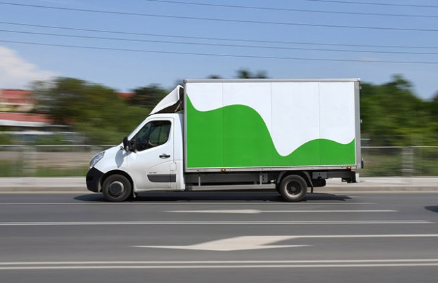Green & white moving van