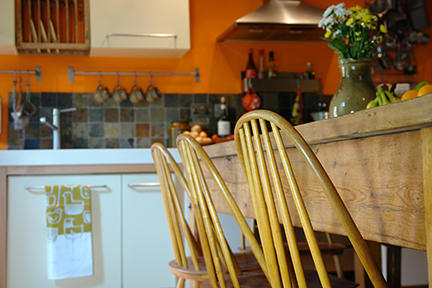 Orange feature wall in our kitchen