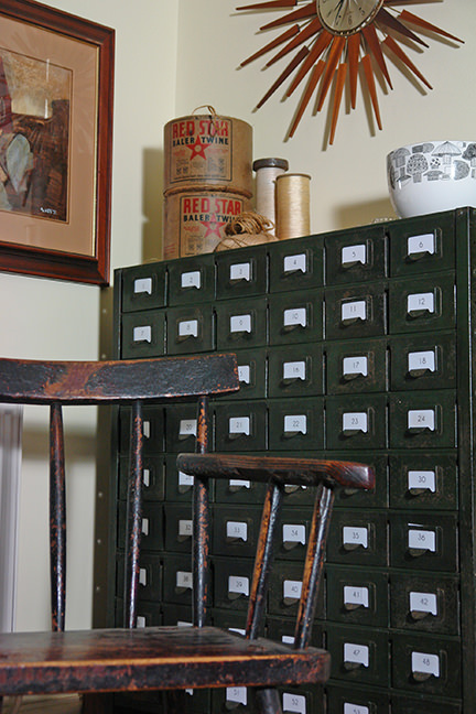 Vintage industrial storage drawers in our sitting room