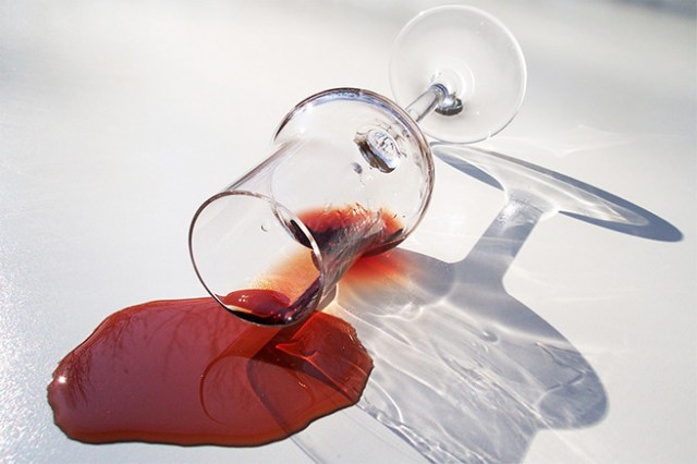 Red wine spill from a wine glass