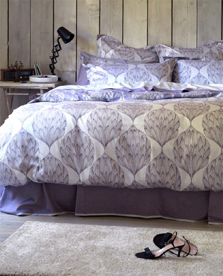 Bed made with Secret Linen 'Artichoke' pattern bedding in purple