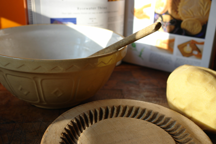 ball of home-made Scottish shortbread dough with antique wooden shortbread mould, vintage pottery mixing bowl and cookery book open on the page with Scottish shortbread recipe | H is for Home