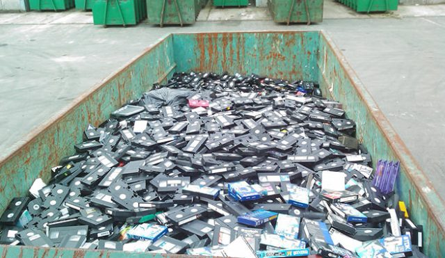 Skip full of plastic VHS video tapes