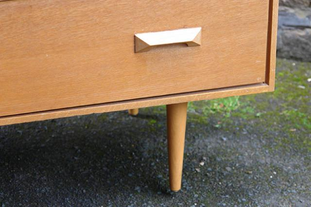 Detail from vintage Stag Furniture chest of drawers showing a leg | H is for Home