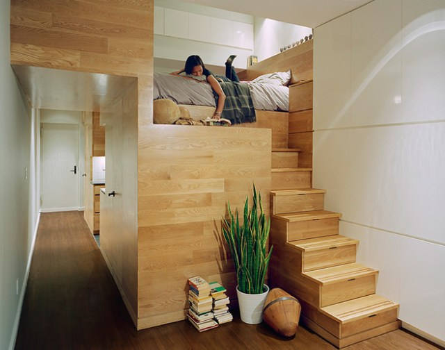 Mezzanine bed platform above a wooden staircase