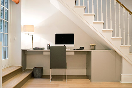 Minimalist under-stairs office