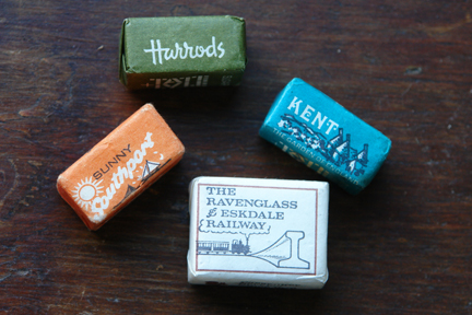 Old paper-wrapped sugar cubes including Harrods, Sunny Southport, Kent and Ravenglass | H is for Home
