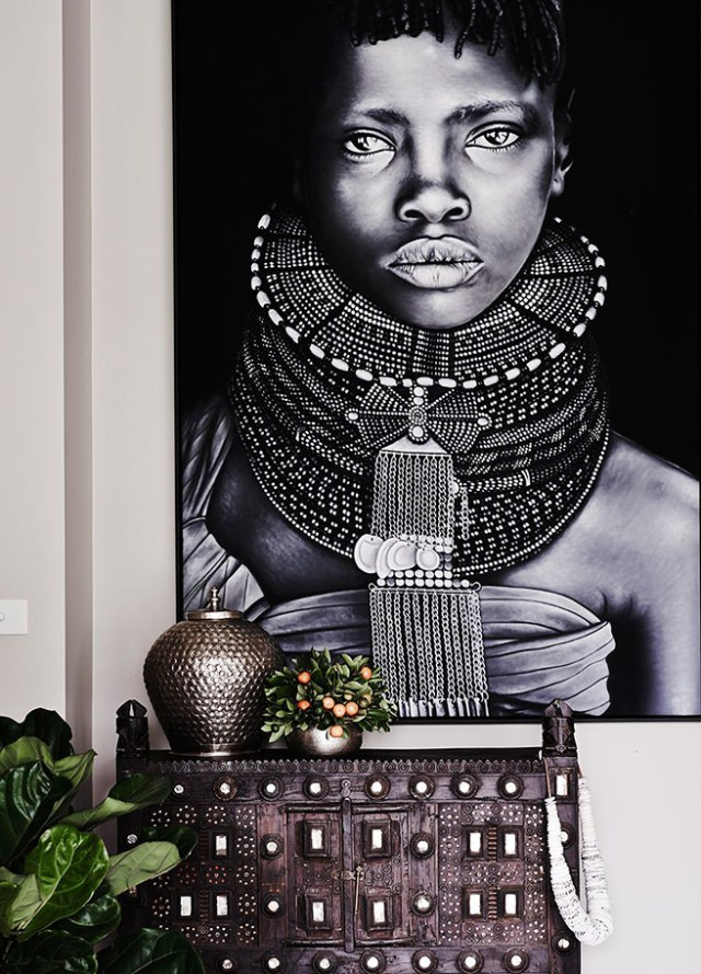Ethnic furniture finds with blown up photograph of an African girl in traditional dress