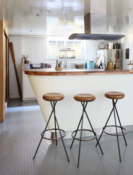 kitchen with vintage industrial stools on a grey rubber floor with underfloor heating