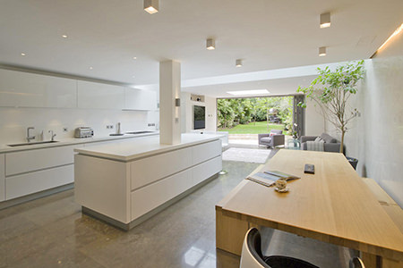 large kitchen with central island and polished tiled floor with underfloor heating