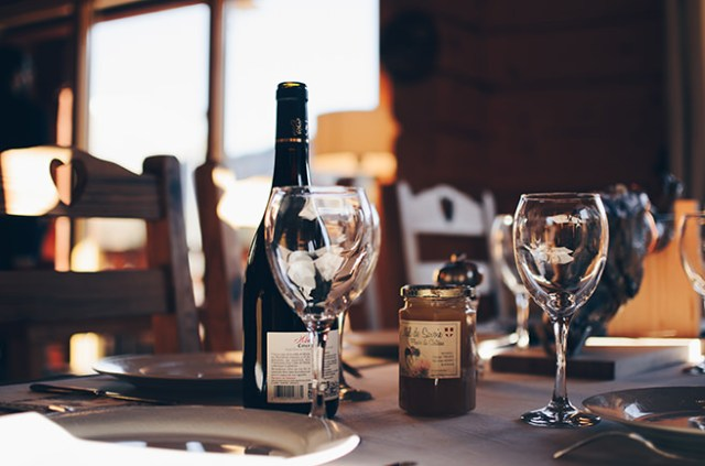 Restaurant table with wine bottle and glasses