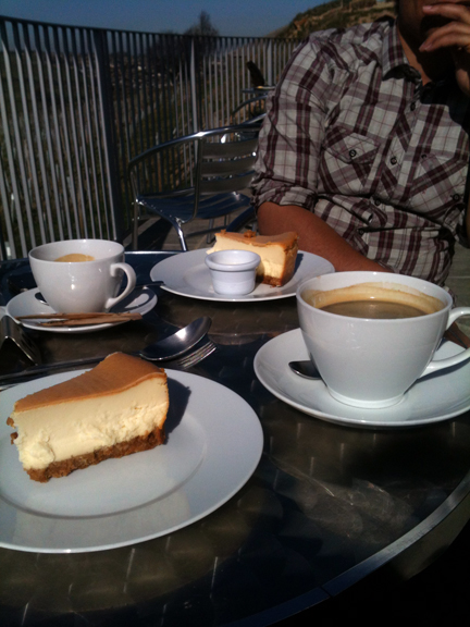 slices of cheesecake & cups of coffee on the terrace of the Holmfirth Vineyard restaurant | H is for Home