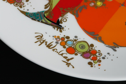 "detail showing the artist's signature from a ""1001 Nights"" porcelain charger designed by Bjørn Wiinblad for his Rosenthal Studio Line"