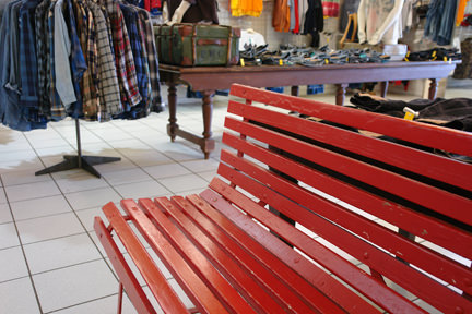 red bench in the cow shop