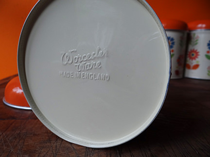 base of vintage storage tin showing embossed Worcester Ware mark