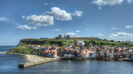 Whitby Harbour with the abbey on the hill in the distance