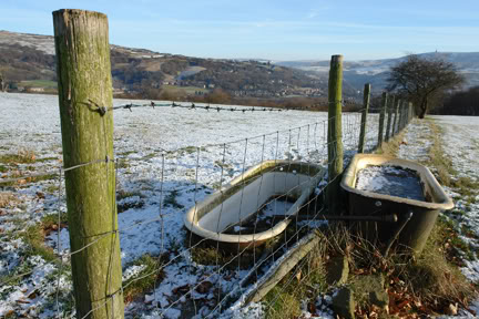 Old baths in a field being used for feeding farm animals | H is for Home