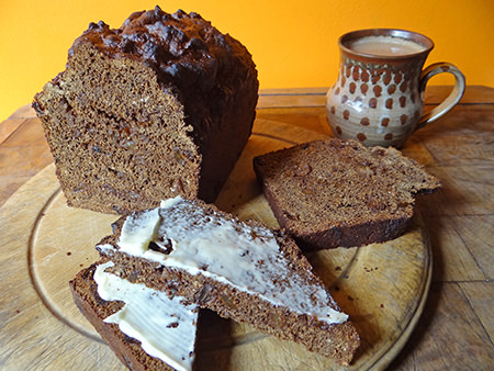 Sliced & buttered home-made black bread with a mug of tea