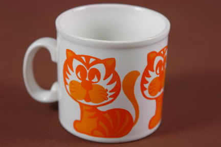 Vintage Staffordshire pottery mug with orange cat illustration | H is for Home