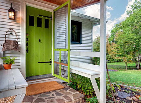 cottage entrance with green flash front door