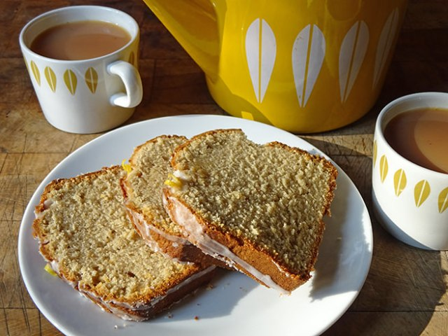 Slices of Earl Grey tea and lemon cake with cups of tea | H is for Home