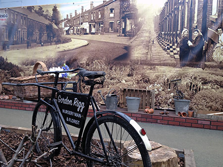 Gordon Rigg installation with vintage photos and delivery bicycle